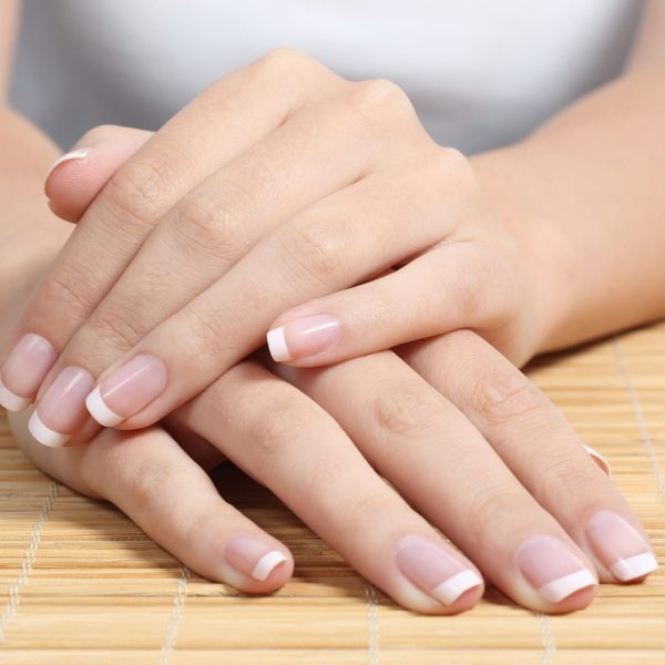 Close up of a beautiful woman hands and nails with perfect french manicure